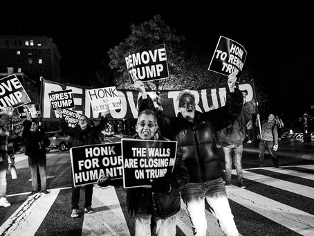 """A """"Honk for Removal"""" Street Party by Night"""