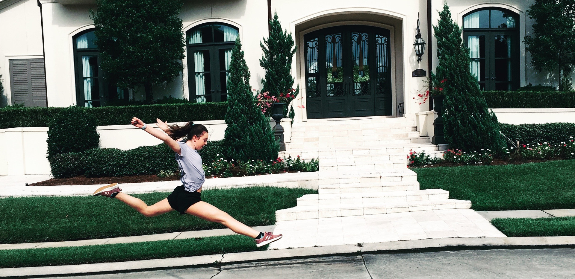 Passion leap infront of house.jpg