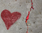 heart with red crack in the sidewalk kea