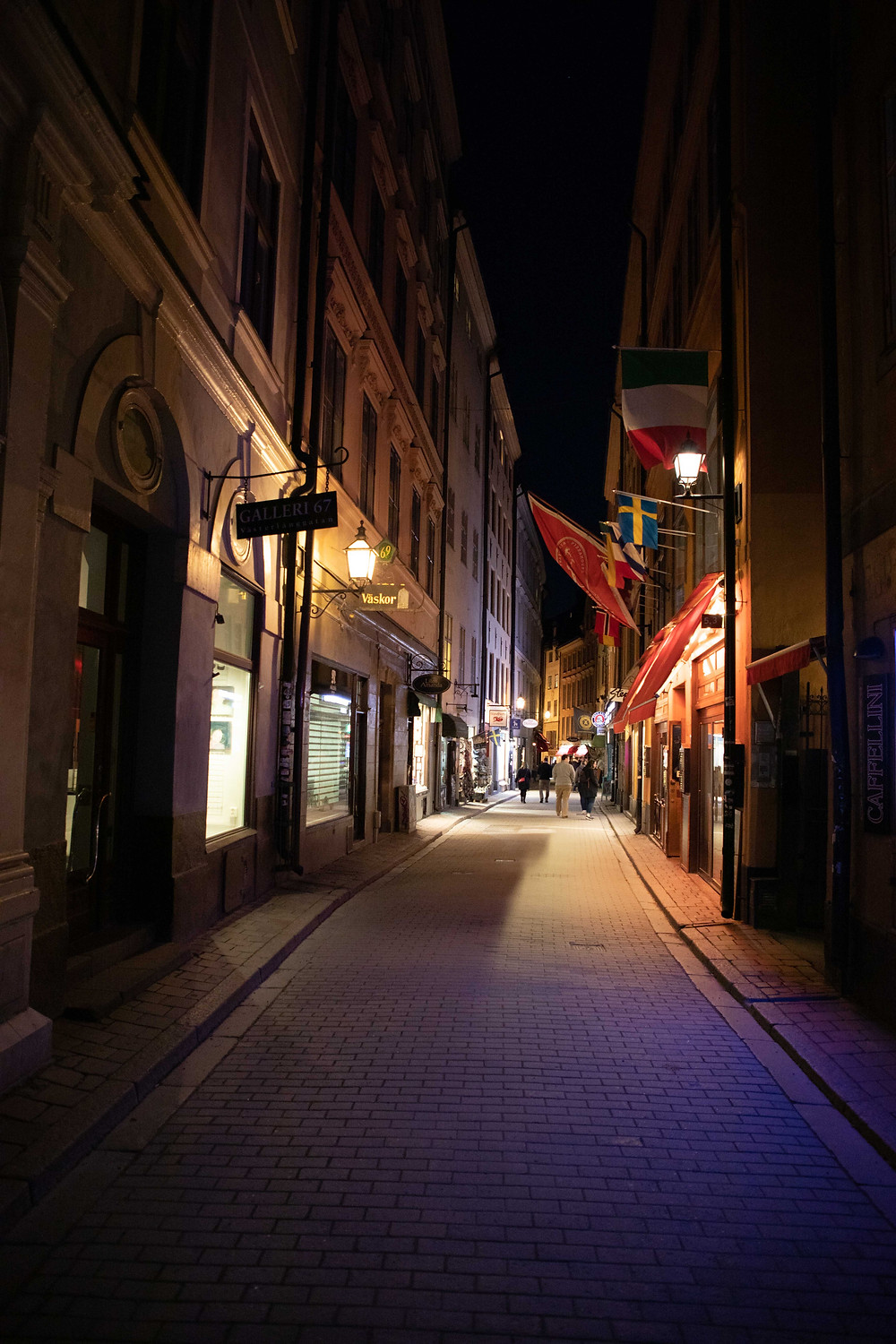 One of the Main streets of Gamla Stan, Stockholm with shops and restaurants.