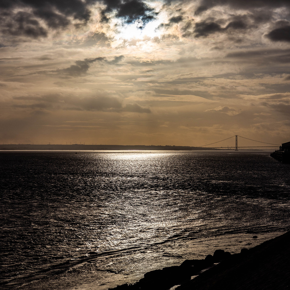 Sun peering through to the river Humber.