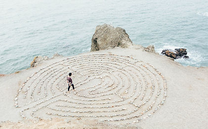 Woman walking Labyrinth on the beach