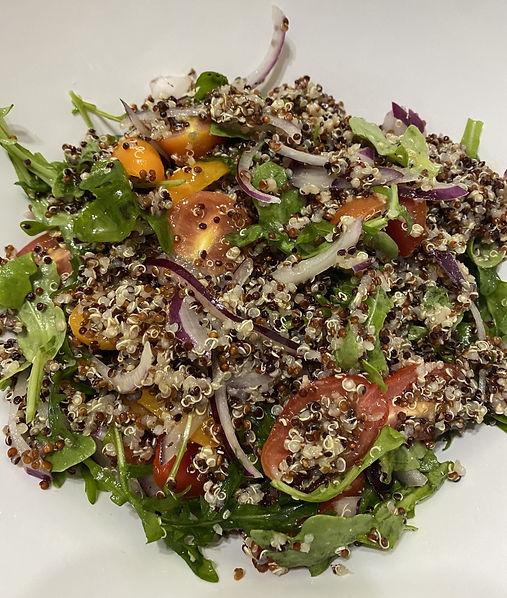 Quinoa, tomato and arugula salad