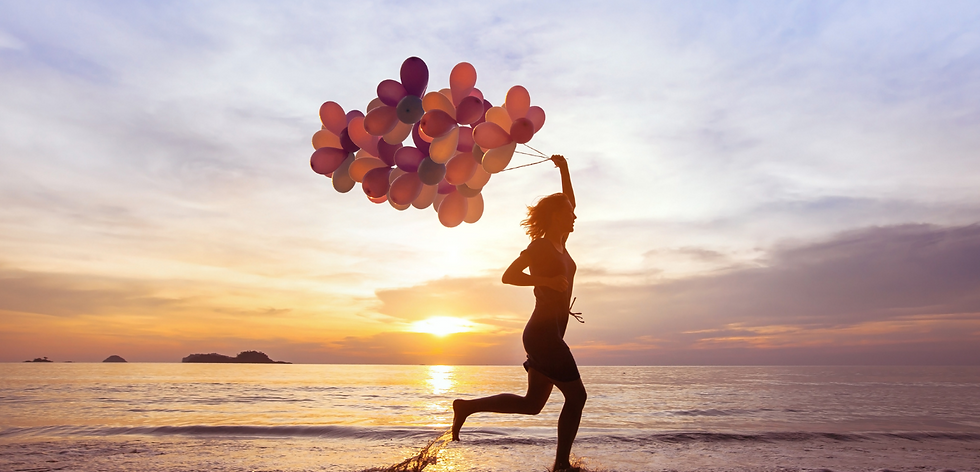 Woman running with a bunch of balloons