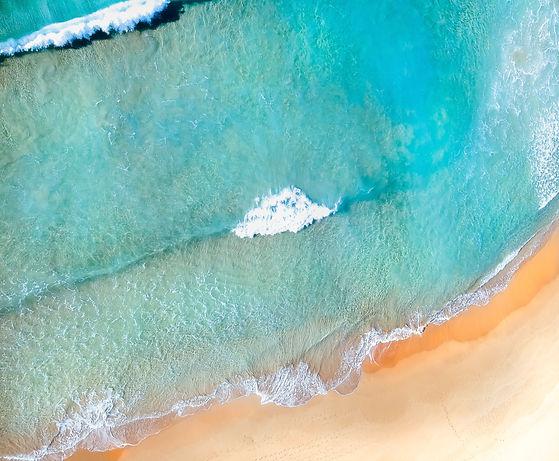 Turquoise blue ocean waters washing ashore