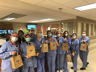 Nurses holding their gift bags from the Frontline worker care package giveaway
