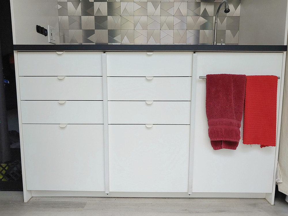 Our van's Ikea cabinet kitchen with simple and easy vertical drawer and door locks. #vanconversionideas