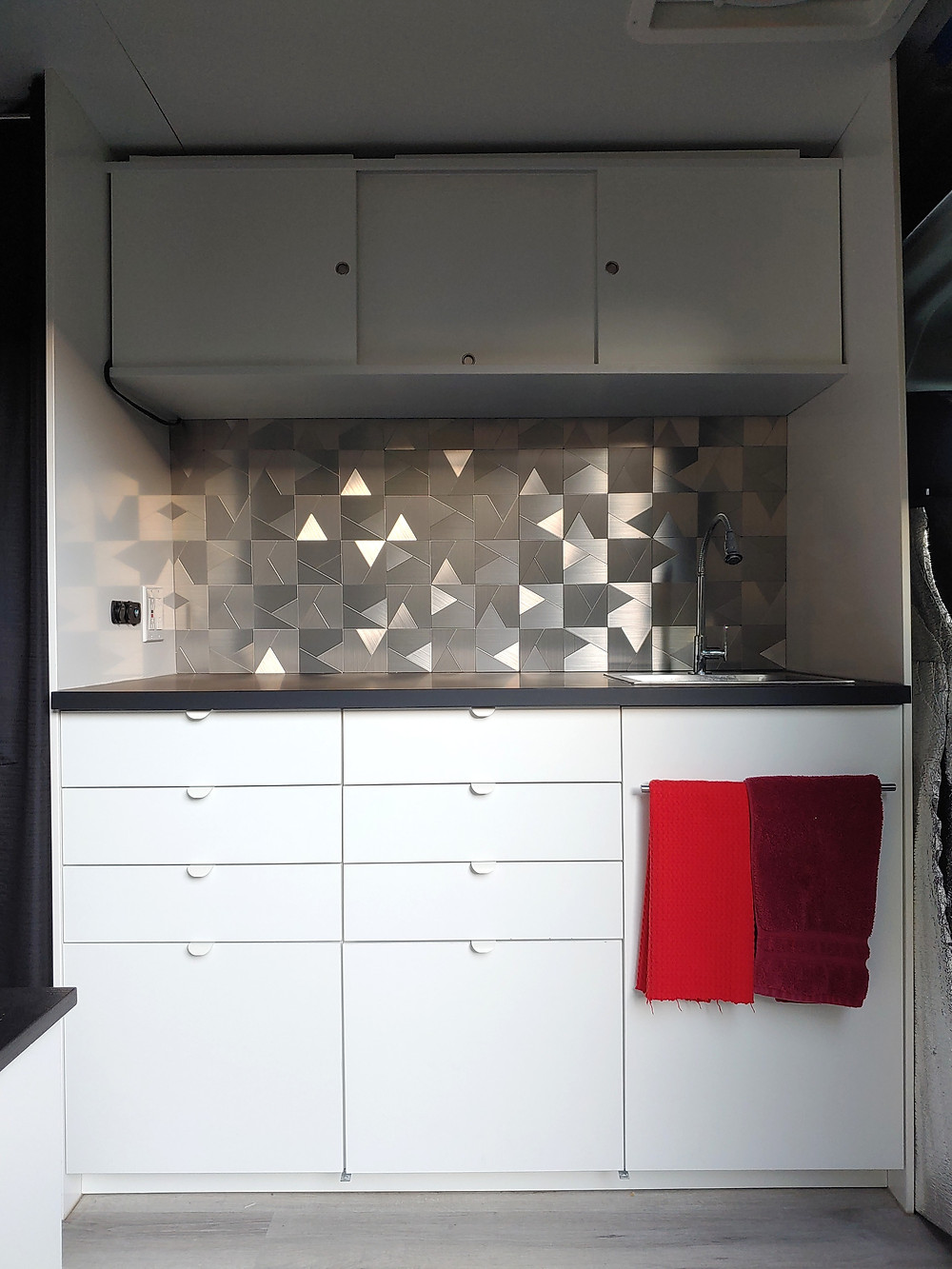 Our kitchen design with Ikea base cabinets and custom built upper cabinets. I love our back splash!