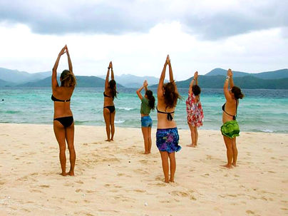practising yoga on Small Bamboo Islands, Palawan, Philippines
