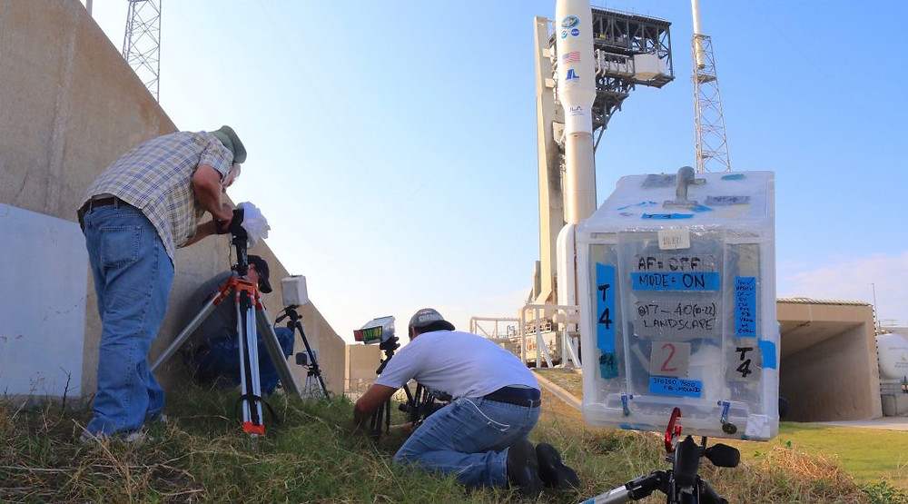Photographers set up their cameras to protect gear for impact of remotely-triggered launch close-ups.