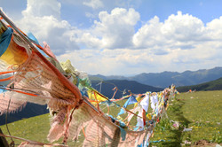 Tibetan prayer flags outside of Litang
