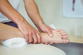Osteopath treating foot injury