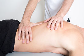 Osteopath treating lower back pain