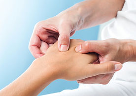 Osteopath treating hand injury