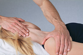 Osteopath treating neck injury
