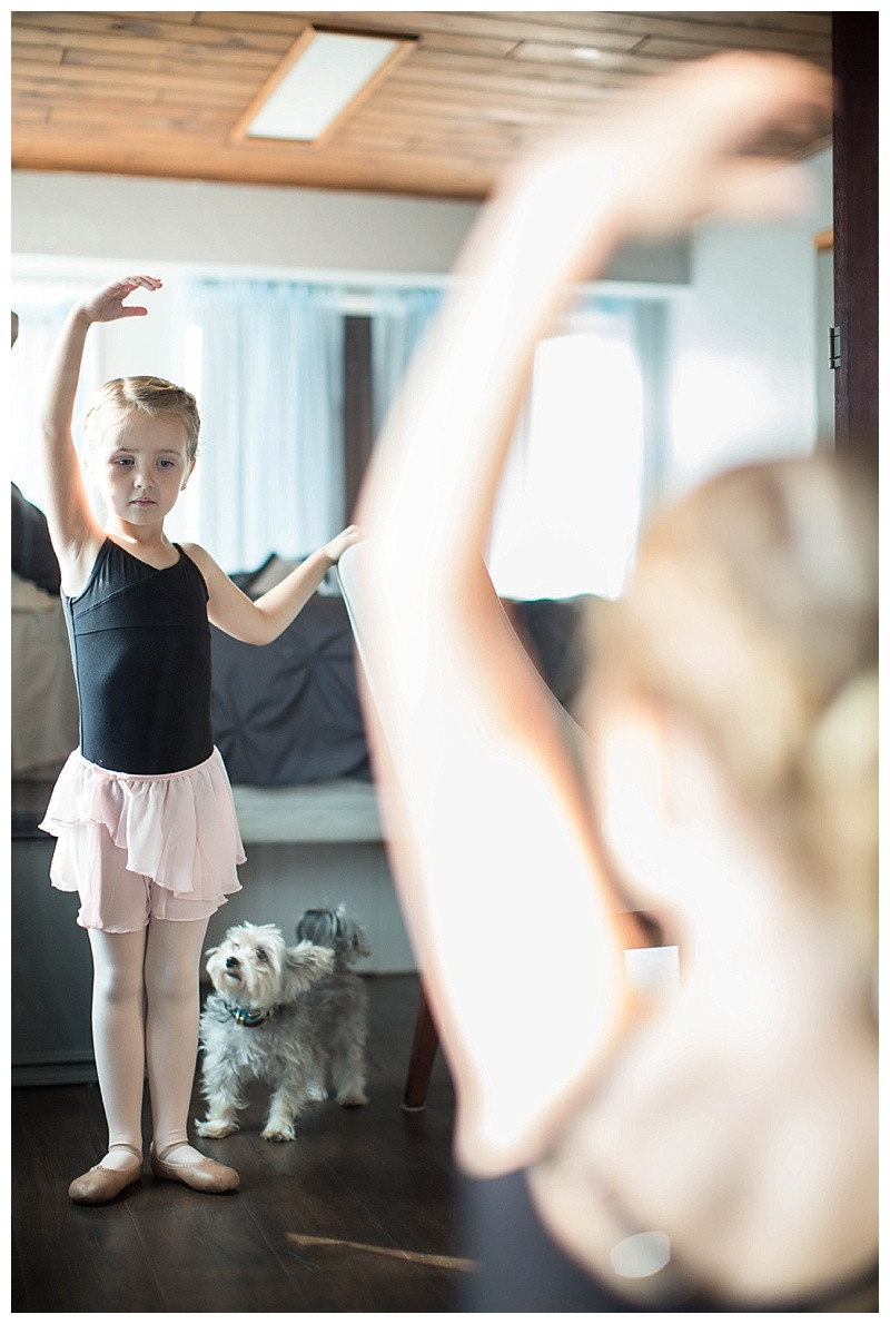 Tiny ballerina looking at the tiny dog