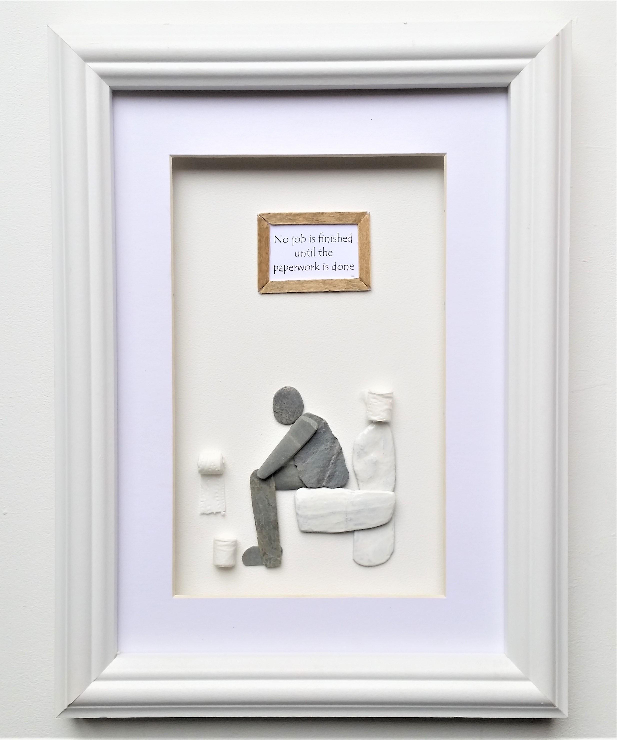 pebble art man on loo