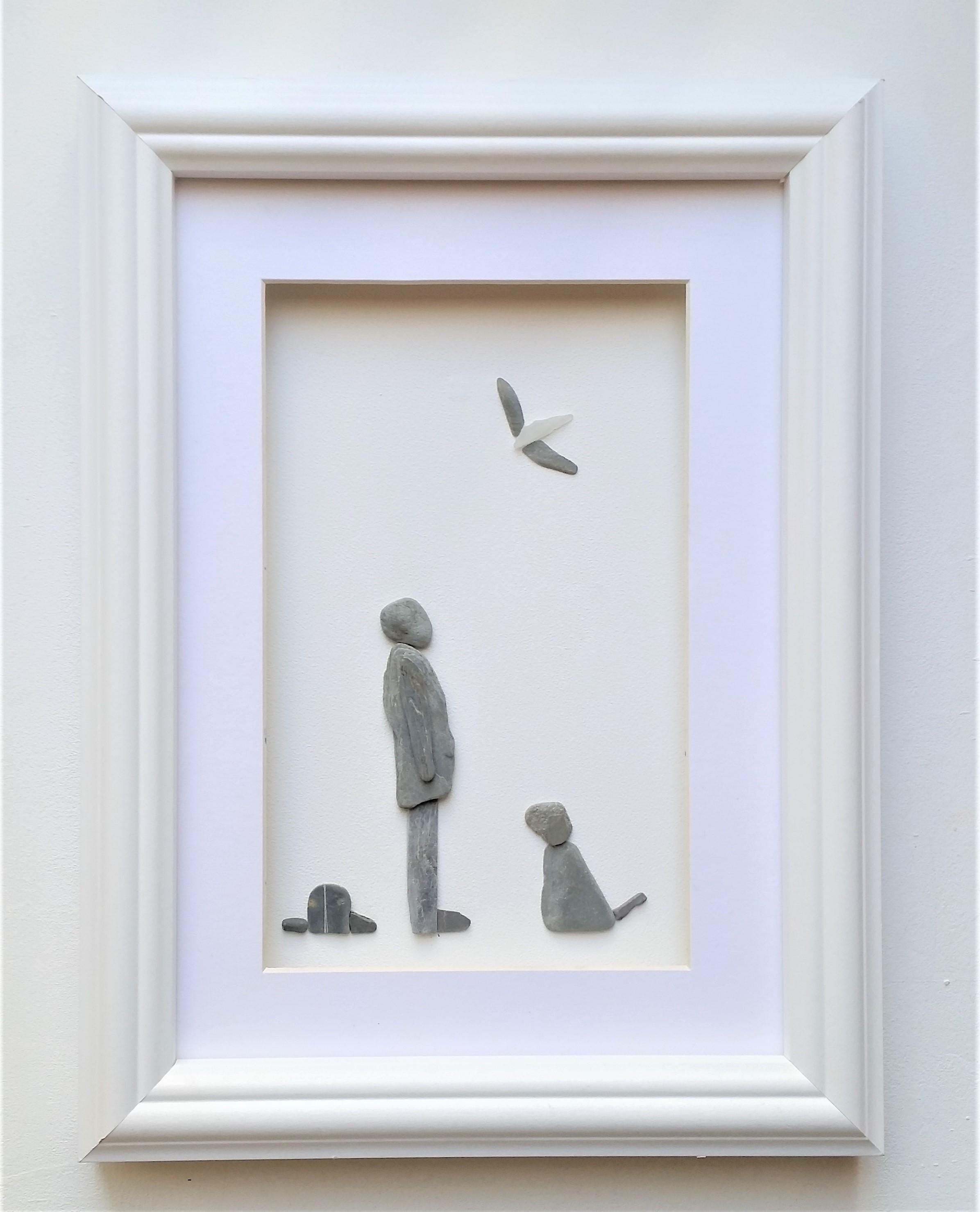 pebble art man and dog