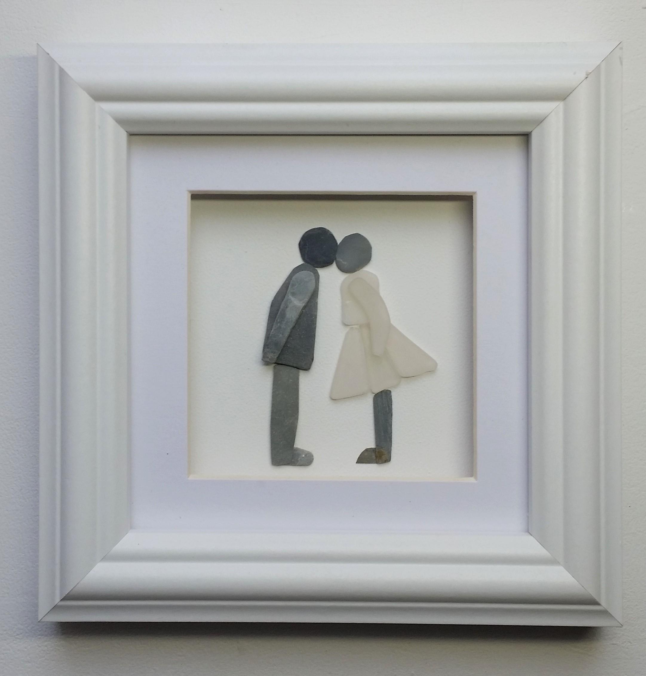 pebble art kissing couple engagement gif