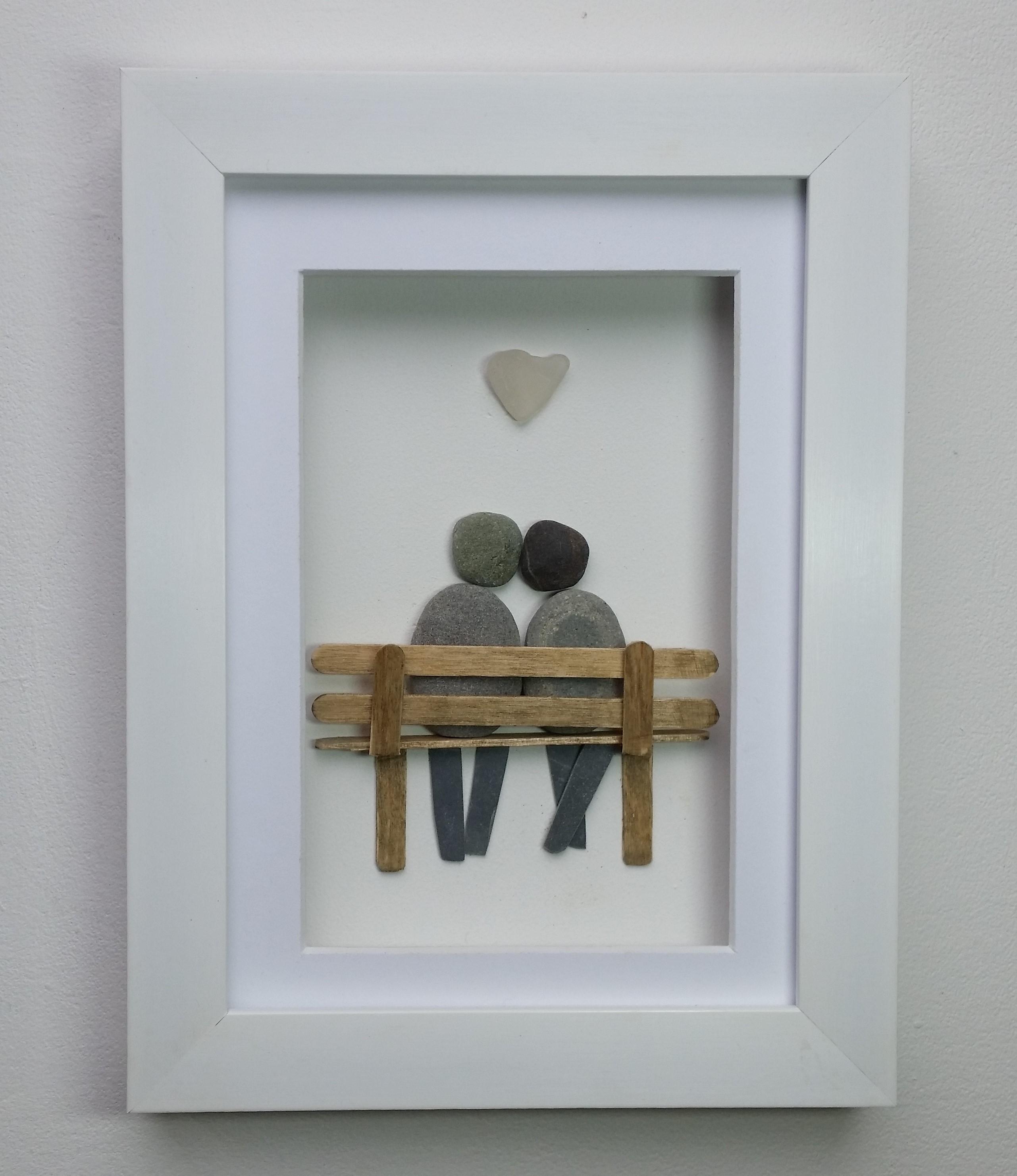 pebble art couple on bench