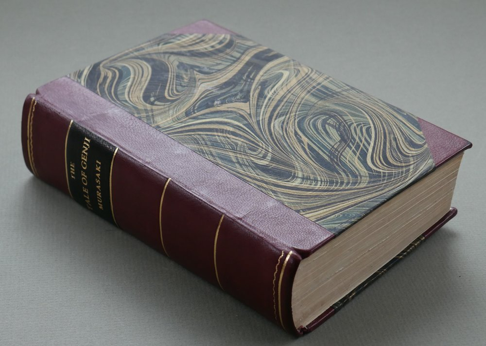 A newly rebound book in leather and marbled paper