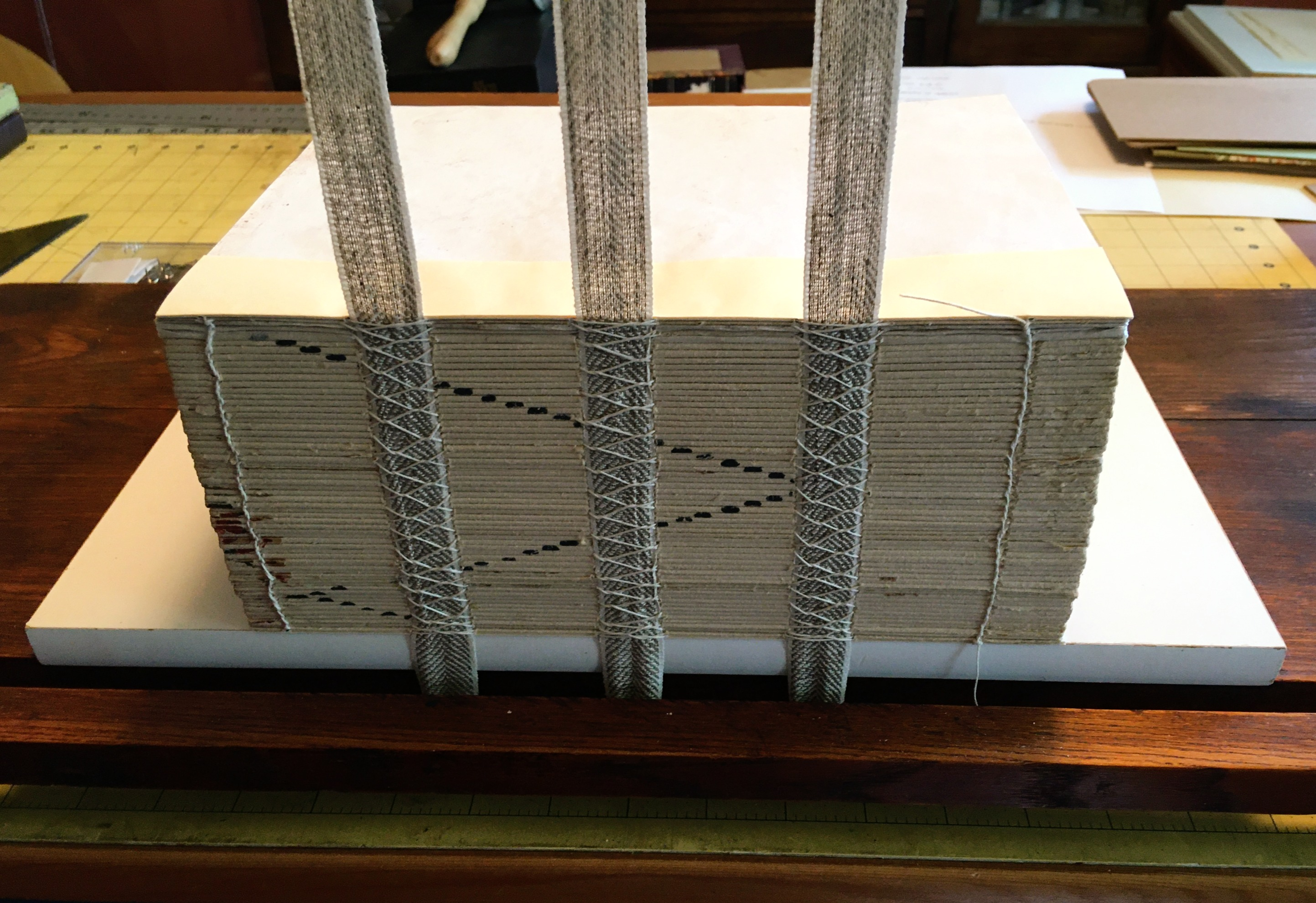 Book getting newly sewn during bookbinding