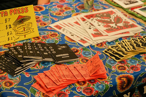 Zines on a table at Milwaukee Zine Fest
