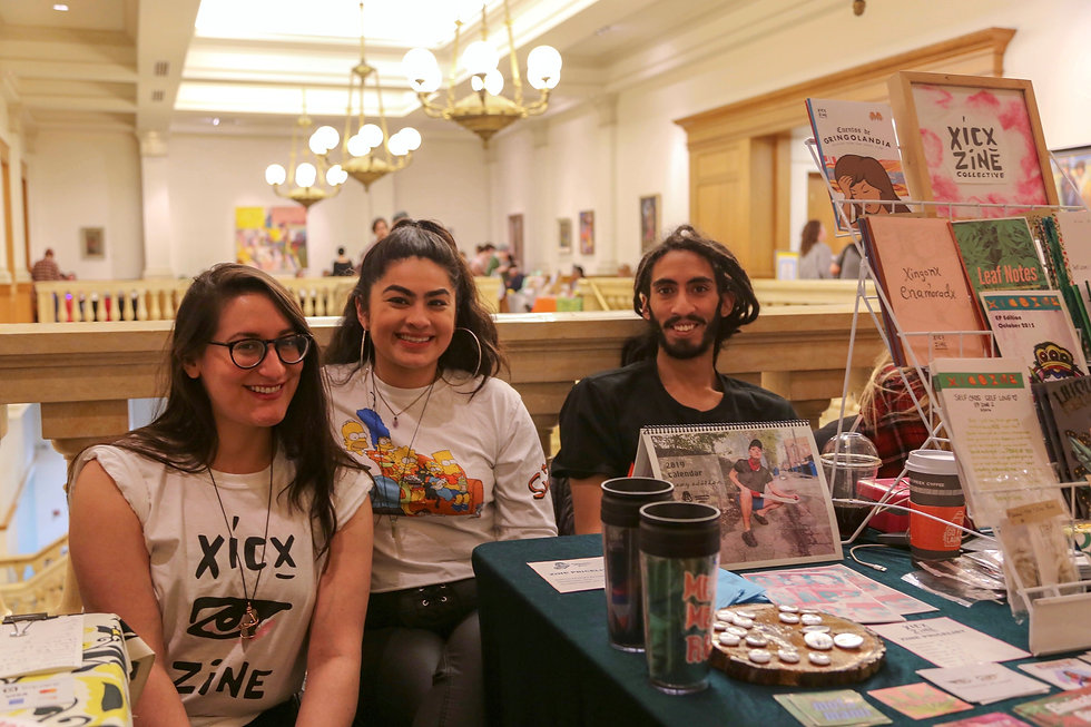 Three small press publishers with zines at Milwaukee Zine Fest