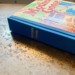 Gold foil stamping on the spine of Mother Goose Book