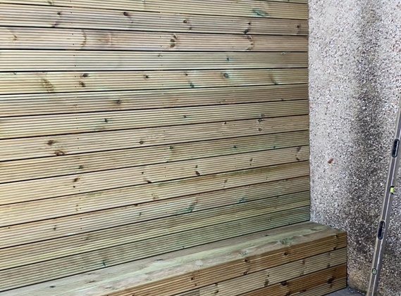Garden wall cladding/fence with seat.