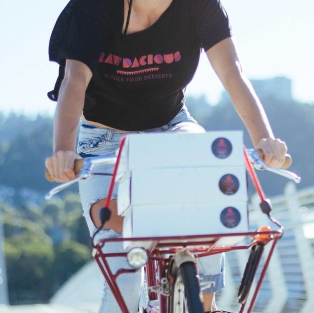 bike delivery rawdacious vegan cheesecake