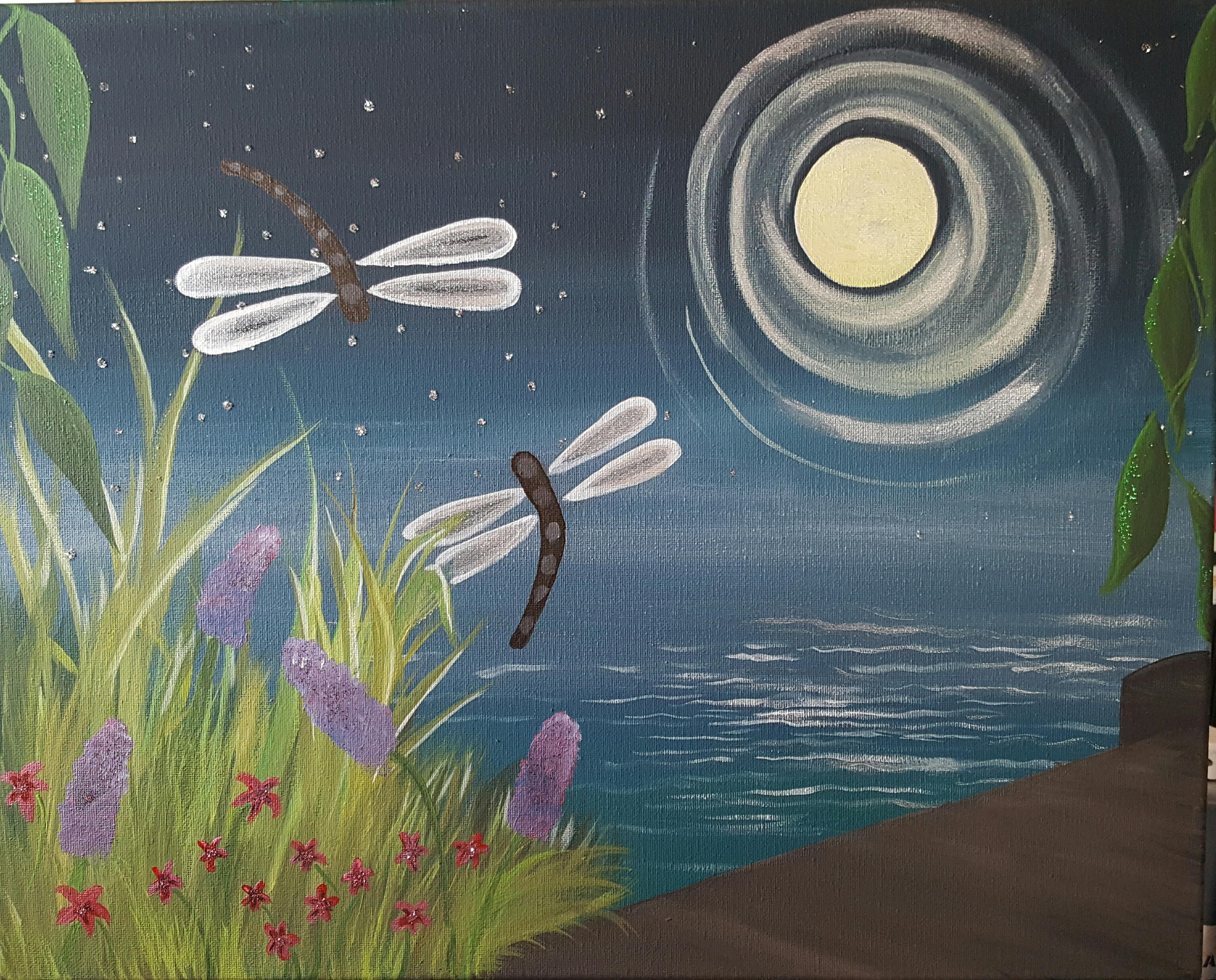 Dragonflies in moonlight