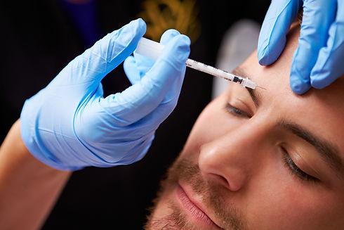 Man Having Botox Treatment At Beauty Cli