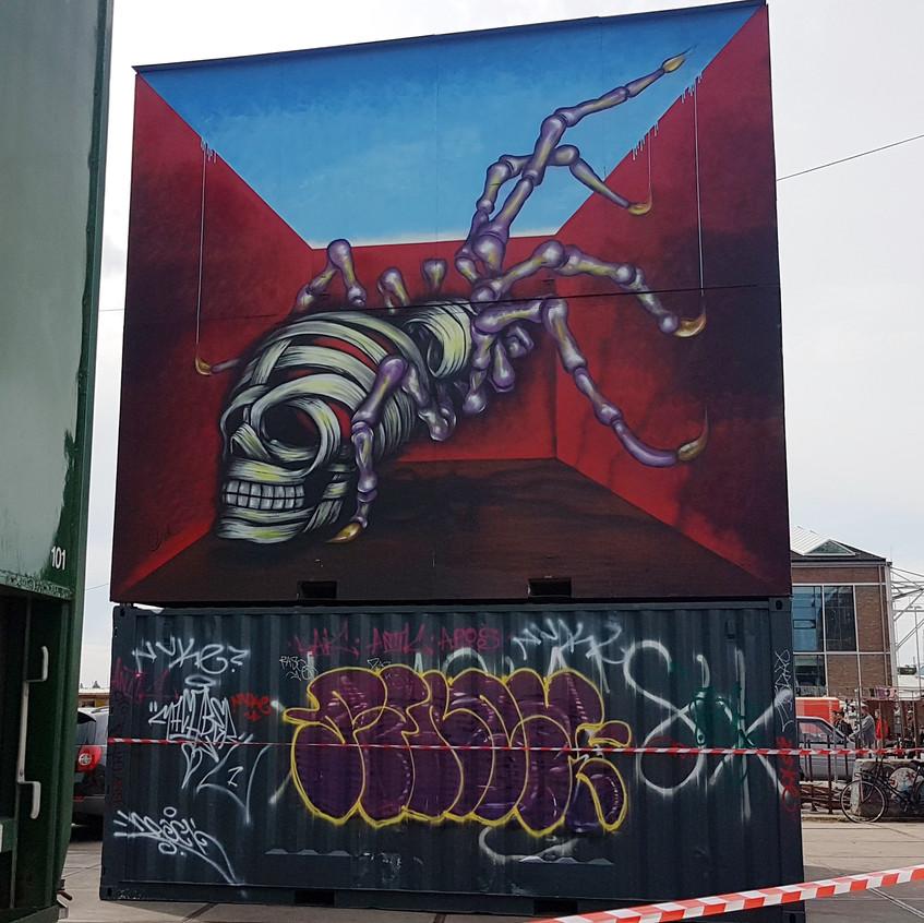 Skelton mural in parking lot