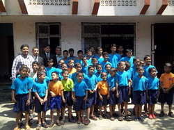 Dr Kurien with young children
