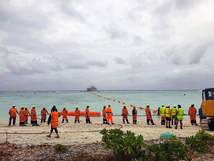 Cable Landing:  SubCom, Optic Marine Group and Avaroa Cable Ltd undertake the complex engineering operation to bring the cable ashore on Aitutaki, Cook Islands December 2019.