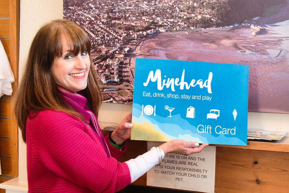 Picture of Sally with a mock-up of the card