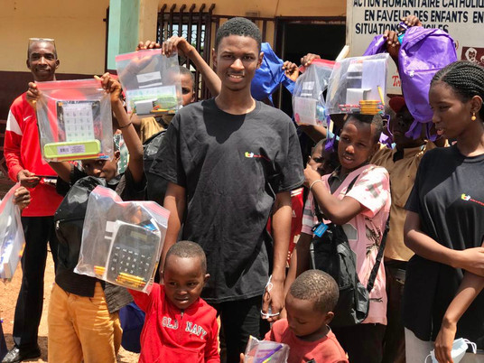 Volunteers touching the hearts and minds of orphans in Guinea (West Africa)