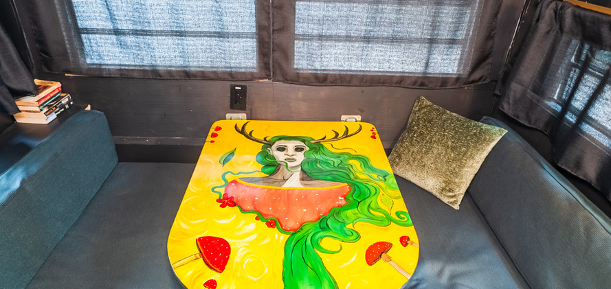 Table painting by RIP camper artist Goodhart Bad Art