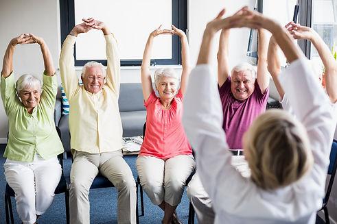 Seniors doing exercises in a retirement
