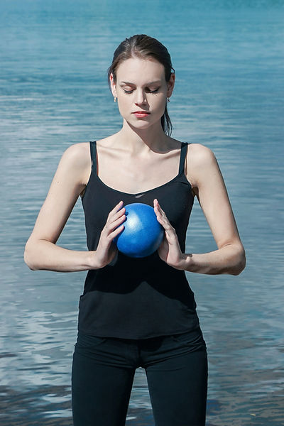 woman doing meditation with chiball by l