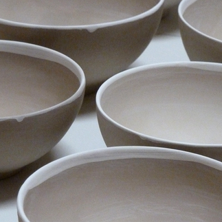 Bone china bowls with aluminum oxide at the edge. .