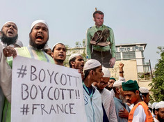 Thousands rally in Bangladesh's capital against the French president's support of secular laws