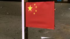 China plants flag on moon