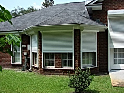 White Roll Up Shutters on Home