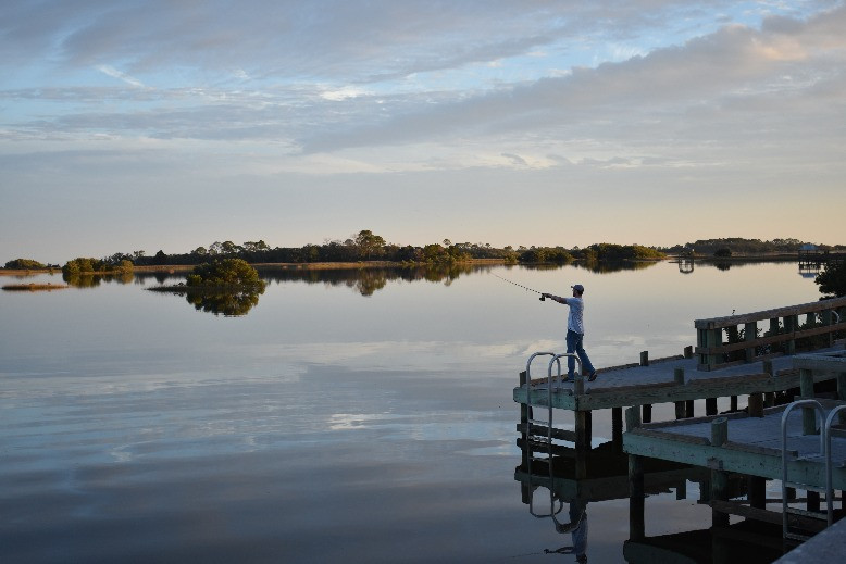 Nick fishing off one of the bridge areas in Cedar Key around sunset.