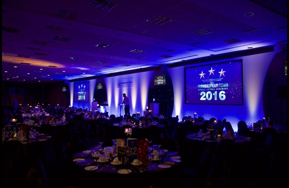Swooshed Even Production provide full audiovisual services for Huddersfield town awards night. Including set staging lighting and video and the all-important loud PA system