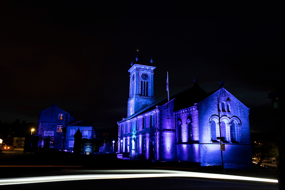 Meltham Church lit up in blue in awareness for Clap for Hero's during the Covid Pandemic