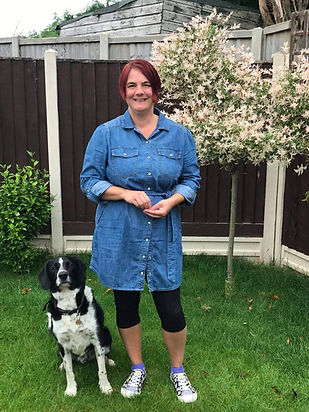 Rev Tania Vaughan and her dog in a garden
