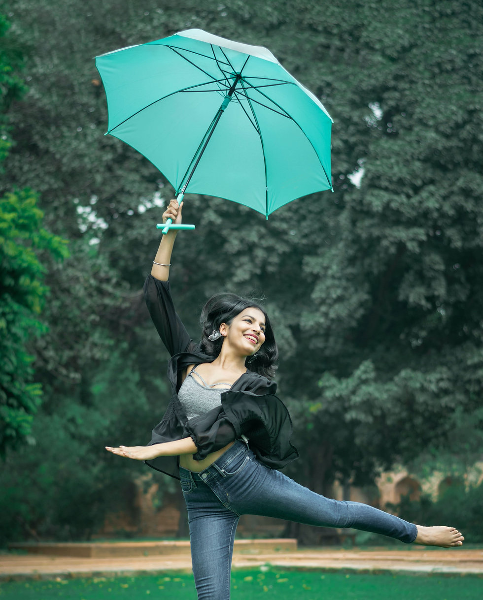 woman-dancing-and-raising-green-umbrella